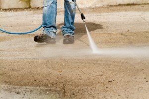 Pressure washing Company - a concrete sidewalk being pressure washed